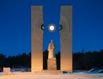 Monument to Kurchatov on the background of a full bright moon. Chelyabinsk, Russia - November 2018: Monument to Kurchatov on the background of a full bright moon stock image