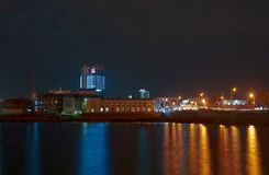 Night view of the Kirovsky Bridge, the Prokofiev Concert Hall and the business center of Chelyabinsk City stock photography