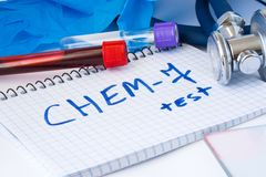 CHEM-7 or biochemical test or blood lab analysis concept photo. On the table in the laboratory are gloves, lab tubes with blood an. D note with the inscription stock image