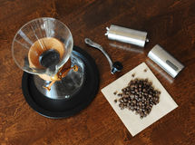 Chemex, coffee and grinder on a wooden table. Chemex, coffee and grinder on a wooden background Royalty Free Stock Photos