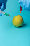 Chemical additives in food or genetically modified fruit concept Royalty Free Stock Photos