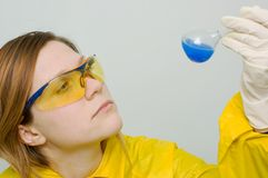 Chemical analysis. Woman with beaker royalty free stock photography