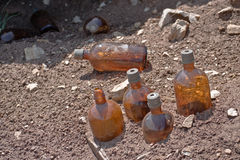 Chemical bottles littering the Mount. Chemical bottles used in mining littering the Mount Royalty Free Stock Images