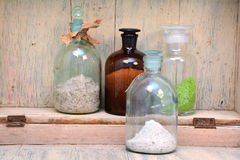 Chemical bottles in a row Royalty Free Stock Images