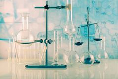 Chemical cabinet. Tripod with laboratory test tubes and flasks stock photos