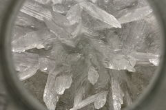 Chemical crystals. A close up of chemical crystal formations under a magnifying glass Royalty Free Stock Images