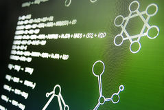 Chemical equation on green table background photo taken from perspective Royalty Free Stock Image