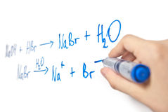 Chemical equation on whiteboard with hand Royalty Free Stock Photography