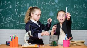 Chemical experiment concept. Safety measures for providing safe chemical reaction. Genius kids work on own chemical. Theory. Basic knowledge of chemistry royalty free stock images