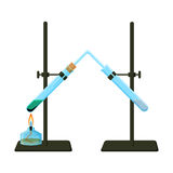 Chemical experiment with two tripods holding test tubes and alcohol burner. Royalty Free Stock Photography