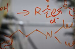 Chemical structure written on glass. Research structures and reactions are written on glass in an organic chemistry lab Royalty Free Stock Photo