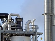 Chemical factory. Exhaust pipes with valves, pipes and towers at a chemical plant Stock Image