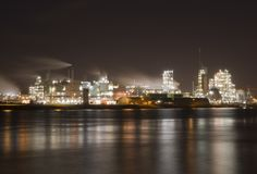 Chemical factory along the river Merwede. Dutch Chemical plant in Dordrecht on the shore of the river Merwede Stock Photography