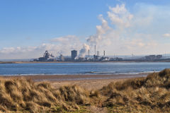 Pollution. Chemical Factory from the Beach Stock Photo