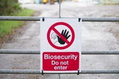 Chemical factory biosecurity sign warning dangerous hazard at entrance gate royalty free stock images