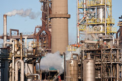 Chemical factory with pipes and smokestacks Royalty Free Stock Image