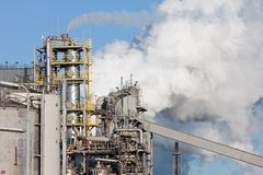 Chemical factory with pipes and smokestacks Royalty Free Stock Photos