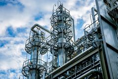Chemical factory. Rectification towers royalty free stock photography