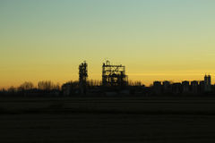 Chemical factory silhouetted at sunset Royalty Free Stock Image
