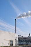 Chemical factory with smoke Stock Image