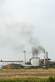 Chemical factory with smoke stack. Black on the sky Royalty Free Stock Photography