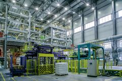 Chemical factory. Thermoplastic production line. Production and packing machinery in large area of industrial hall.  royalty free stock photo