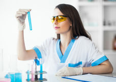 Chemical female researcher holding flask in laboratory Stock Photos