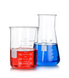 Chemical flask with a blue laboratory test tubes inside Royalty Free Stock Photography