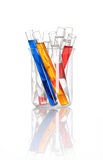 Chemical flask with a colored test tubes inside Royalty Free Stock Images