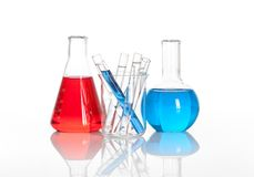 Chemical flask with a glass test tubes inside Royalty Free Stock Photos