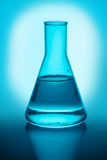 Chemical flask with liquid Stock Photography