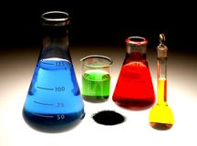 Chemical Flasks. With colored liquid & powder on a graduated background royalty free stock image