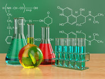 Chemical flasks and blackboard with formulas. Royalty Free Stock Images