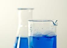 Chemical flasks with blue liquid Stock Photos