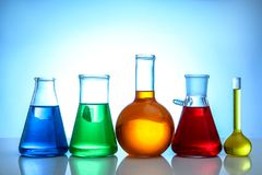 Chemical flasks. On light background royalty free stock photo