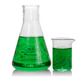 Chemical flasks with green liquid. On white background royalty free stock photo