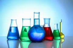Chemical flasks. On light background royalty free stock images
