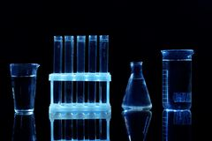 Chemical flasks and test-tubes. On black background stock image