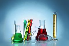Chemical flasks and test-tubes. On color background stock photography