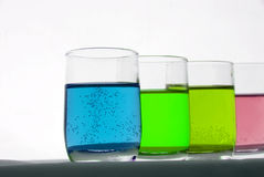 Chemical fluids. Many different coloured chemical solutions in laboratory glasses - chemistry concept Stock Image