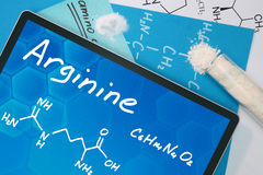 Chemical formula of  Arginine  . Tablet with the chemical formula of Arginine . Amino acids Stock Photos