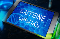 The chemical formula of caffeine. The chemical formula of  caffeine on a tablet with test tubes Royalty Free Stock Images