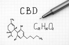 Chemical formula of Cannabidiol CBD with black pen. Close-up stock photo