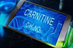 The chemical formula of carnitine. On a tablet with test tubes Stock Images