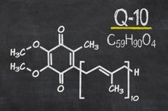 Chemical formula of coenzyme q10. Blackboard with the chemical formula of coenzyme q10 Royalty Free Stock Photo