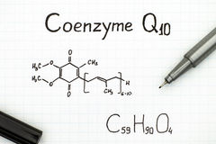 Chemical formula of Coenzyme Q10 with pen Stock Photo