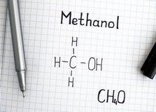 Chemical formula of Methanol with black pen. Closeup royalty free stock image