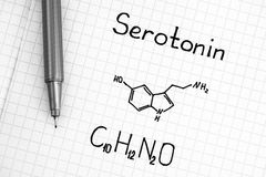 Chemical formula of Serotonin with black pen. Close-up stock image