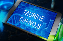 The chemical formula of Taurine. The chemical formula of  Taurine on a tablet with test tubes Stock Images