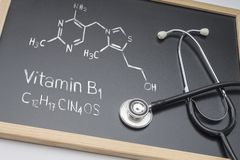 Chemical formula of vitamin B1 drawn on a whiteboard together wi royalty free stock photo